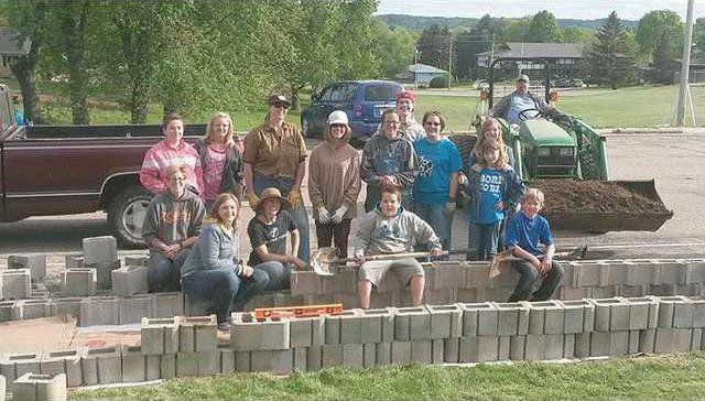 community members putting garden together