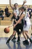 Juda's Anna Skoumal is double-teamed