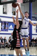 Monticello junior Pete Gustafson blocks a shot